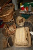 A SELECTION OF WICKERWARE TO INCLUDE A COT AND BASKETS