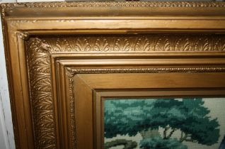 A LARGE ANTIQUE GILT FRAME, with Acanthus moulded detail throughout, with an inset tapestry of a