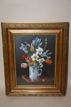 A GILT FRAMED AND GLAZED STILL LIFE OIL PAINTING OF FLOWERS IN A MUG SIGNED W. BADILELLEY LOWER