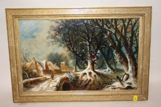 A GILT FRAMED OIL ON BOARD DEPICTING A RURAL WOODED VILLAGE SCENE WITH FIGURE CROSSING A BRIDGE