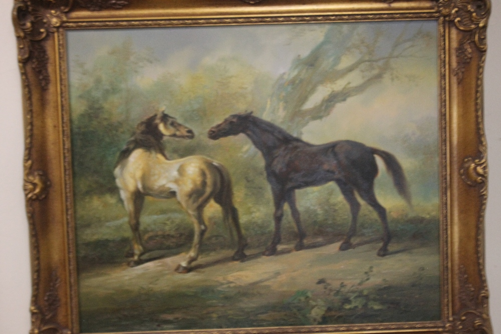 A FRAMED OIL DEPICTING HORSES, signature indistinct - Image 2 of 2