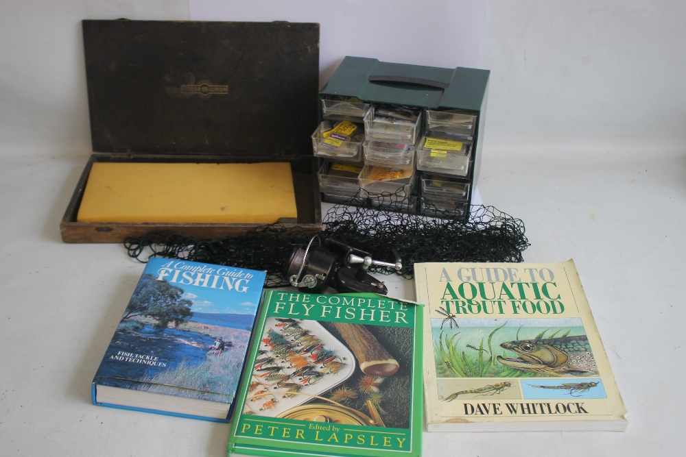 A SMALL CHEST OF ASSORTED FISHING HOOKS VARIOUS SIZES, together with a Mitchell 300 reel, a Moore
