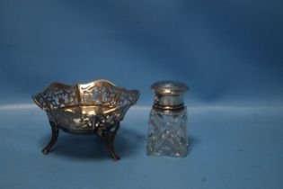 A HALLMARKED SILVER PIERCED BASKET, together with a silver topped bottle (2)