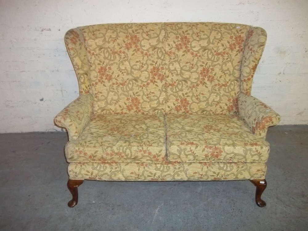 A FABRIC TWO SEATER SOFA WITH QUEEN ANN STYLE LEGS