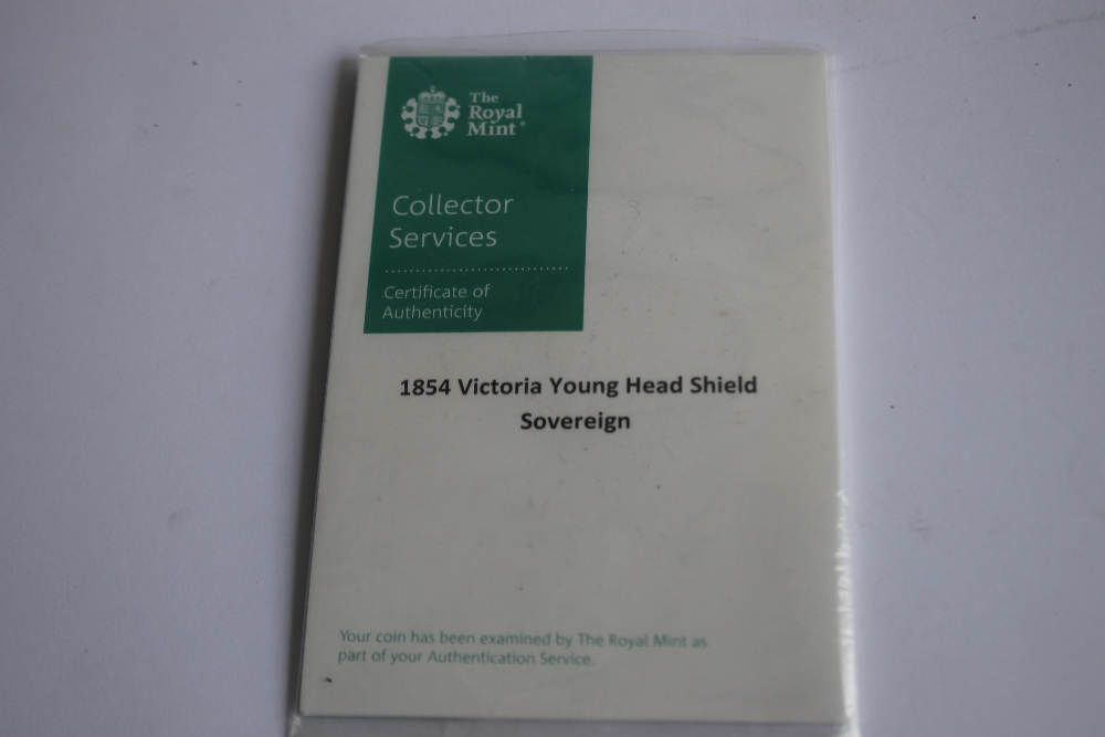 A VICTORIAN 1854 SHIELD BACK SOVEREIGN IN ROYAL MINT COLLECTORS SERVICES PACKET