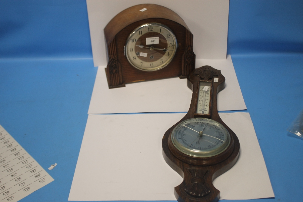 AN OAK MANTEL CLOCK AND A BAROMETER