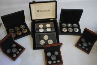 A COLLECTION OF BOXED COMMEMORATIVE COINS, to include three Edward VIII retro sets, a set of St