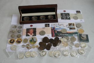 A COLLECTION OF MODERN COMMEMORATIVE COINS, to include a cased set of St Helena 2013 sea life