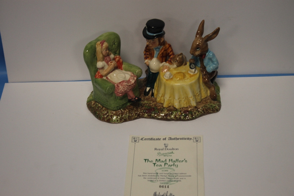 A ROYAL DOULTON BESWICKWARE FIGURE GROUP 'THE MAD HATTER'S TEA PARTY'