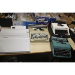 FOUR TYPEWRITERS to include a Corona