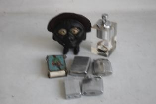 A VINTAGE SAVE AND SMILE MONEY BOX, and a quantity of cigarette lighters