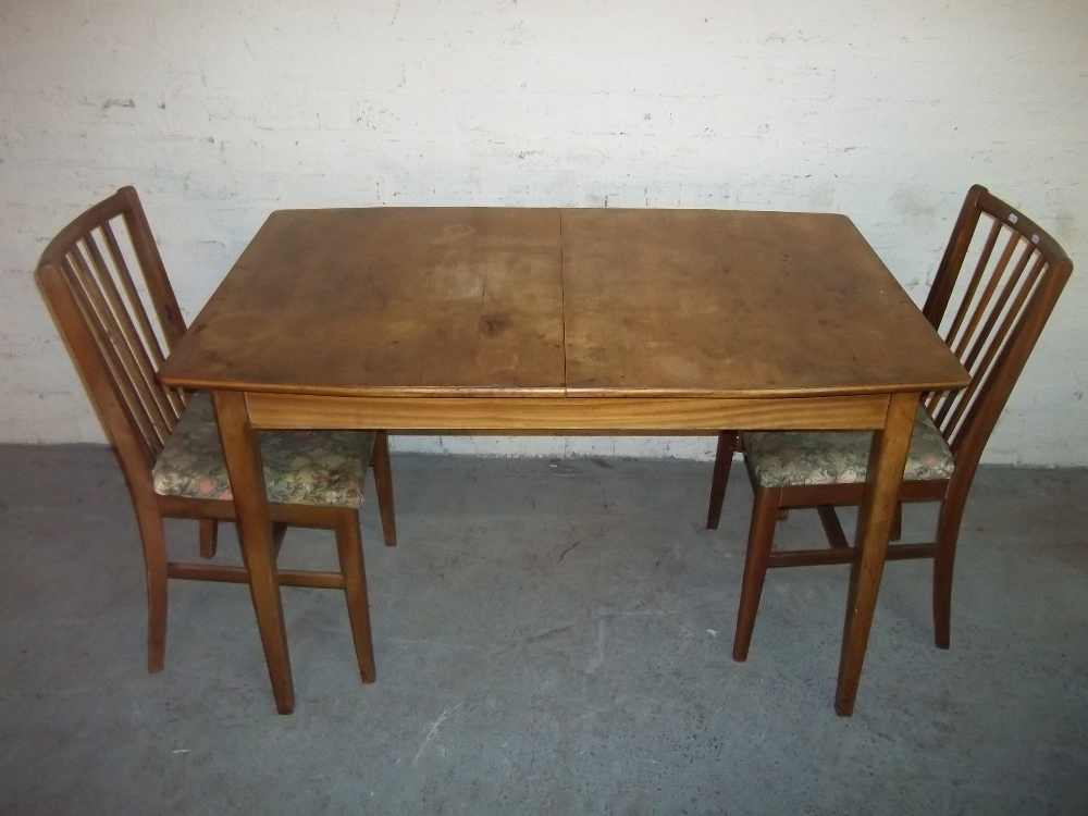 A TEAK EXTENDING DINING SET WITH TWO CHAIRS