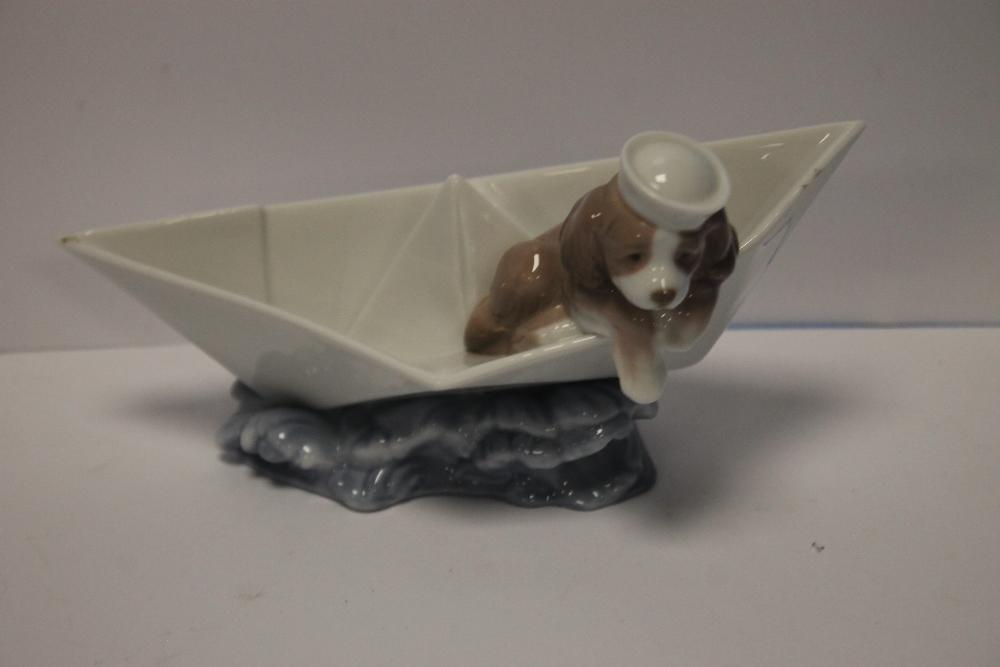 A LLADRO DOG IN A BOAT