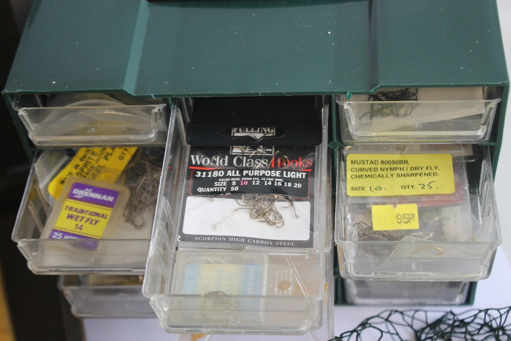 A SMALL CHEST OF ASSORTED FISHING HOOKS VARIOUS SIZES, together with a Mitchell 300 reel, a Moore - Image 2 of 3