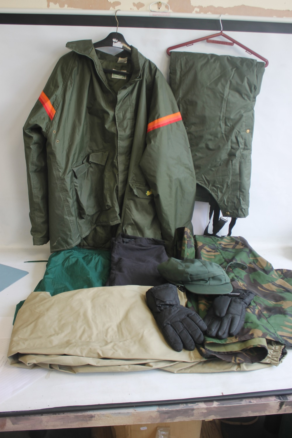 A COLLECTION OF ASSORTED FISHING CLOTHING, to include a Cormoran jacket and braces size XXXL, a