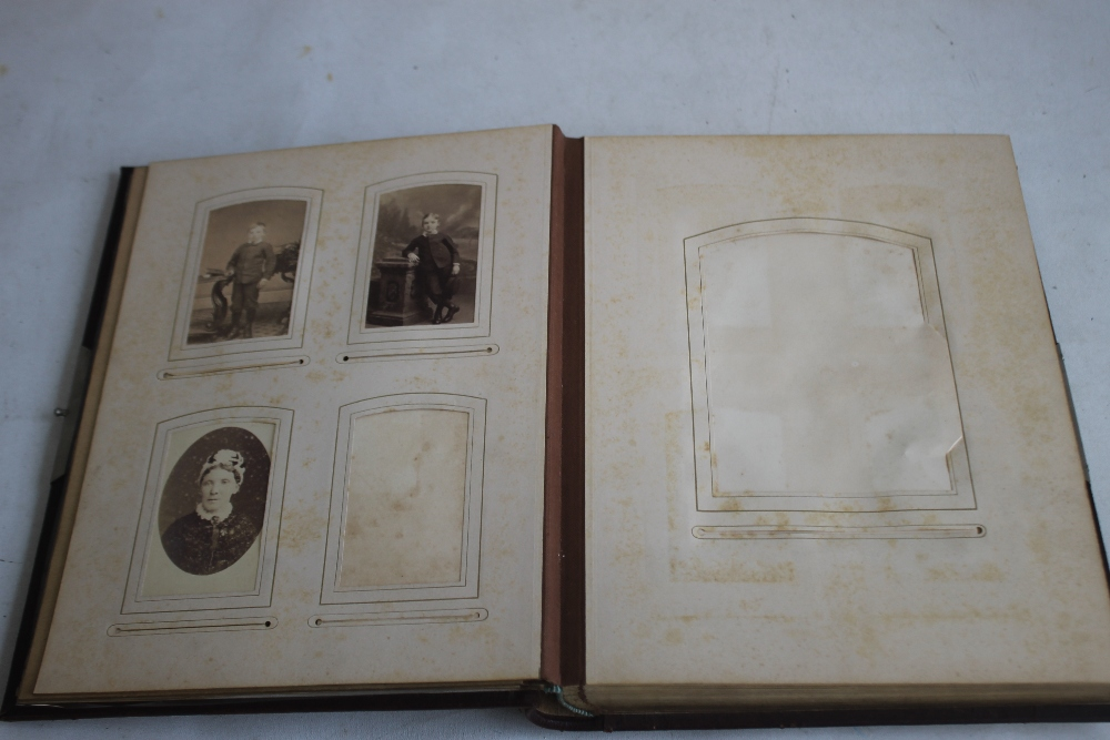 A VICTORIAN LEATHER BOUND PHOTOGRAPH ALBUM WITH CONTENTS, mainly portraits some decorated pages - Image 3 of 6