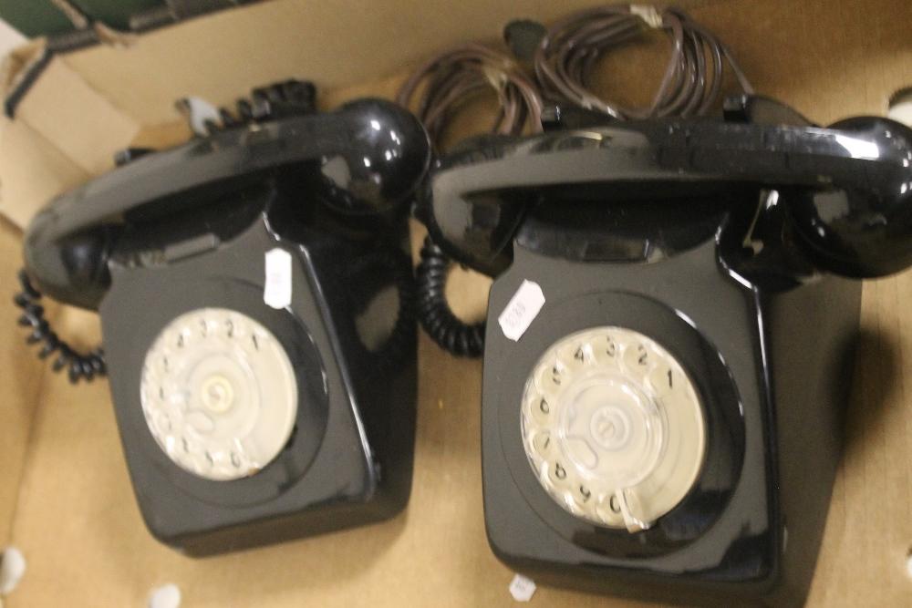A PAIR OF VINTAGE BLACK DIAL TELEPHONES