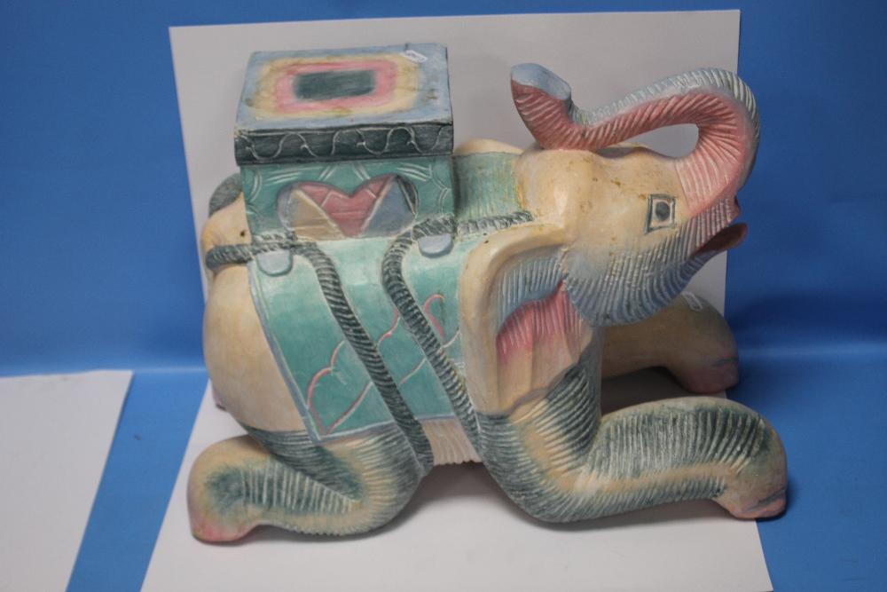A LARGE CERAMIC ELEPHANT