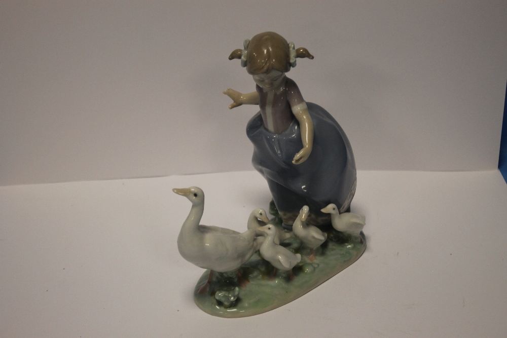 A LLADRO FIGURE GROUP of a girl and geese