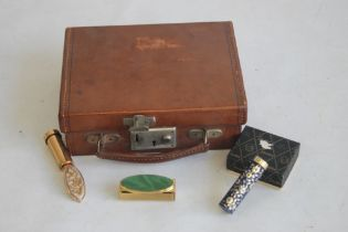 A MINIATURE CHILD'S LEATHER SUITCASE, together with a boxed stratton lipstick mirror and two other