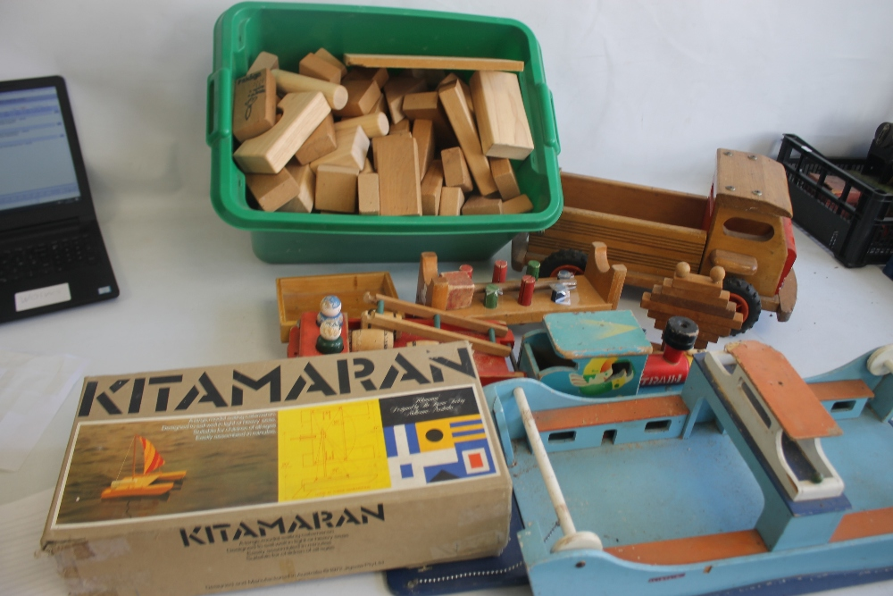 A QUANTITY OF WOODEN TOYS to include a boxed Kitmaran model, large vintage ferry, home built trucks,