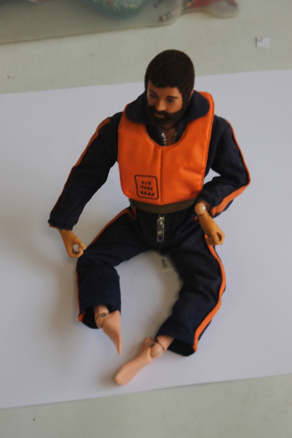 A VINTAGE ACTION MAN EAGLE EYES FIGURE WITH DARK FLOCK HAIR AND BEARD, in flying suit and USAF