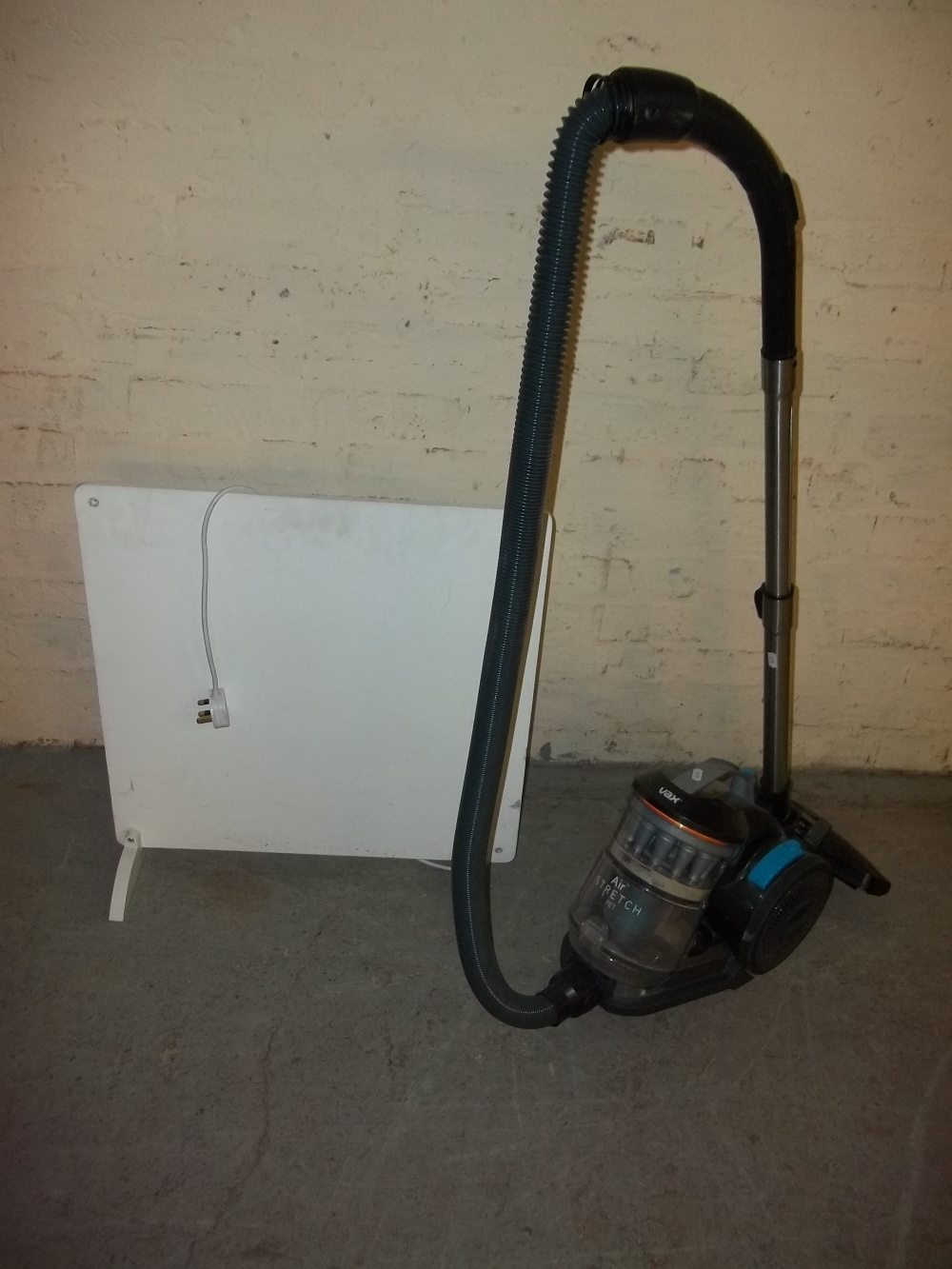 A VAX HOOVER AND A PANEL WALL HEATER