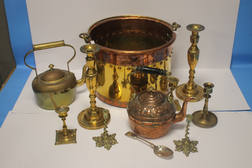 A COPPER AND BRASS COAL BUCKET together with a quantity of candlestick holders, copper kettle etc.