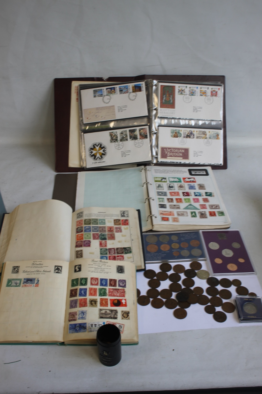 TWO ALBUMS OF BRITISH AND WORLD STAMPS IN ALBUMS AND ON COVERS, together with a small quantity of