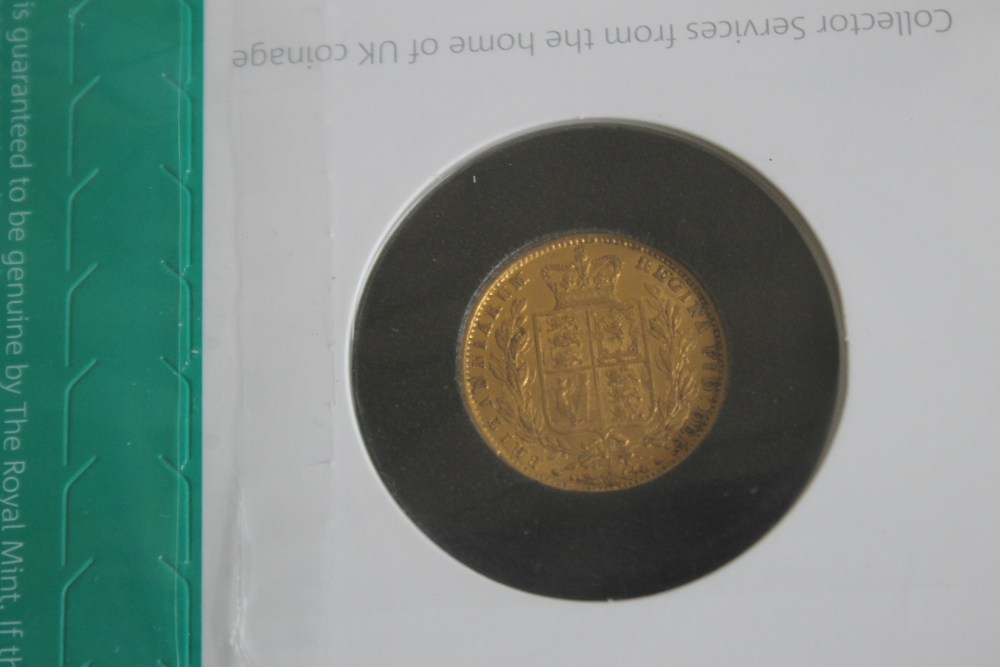 A VICTORIAN 1854 SHIELD BACK SOVEREIGN IN ROYAL MINT COLLECTORS SERVICES PACKET - Image 2 of 2