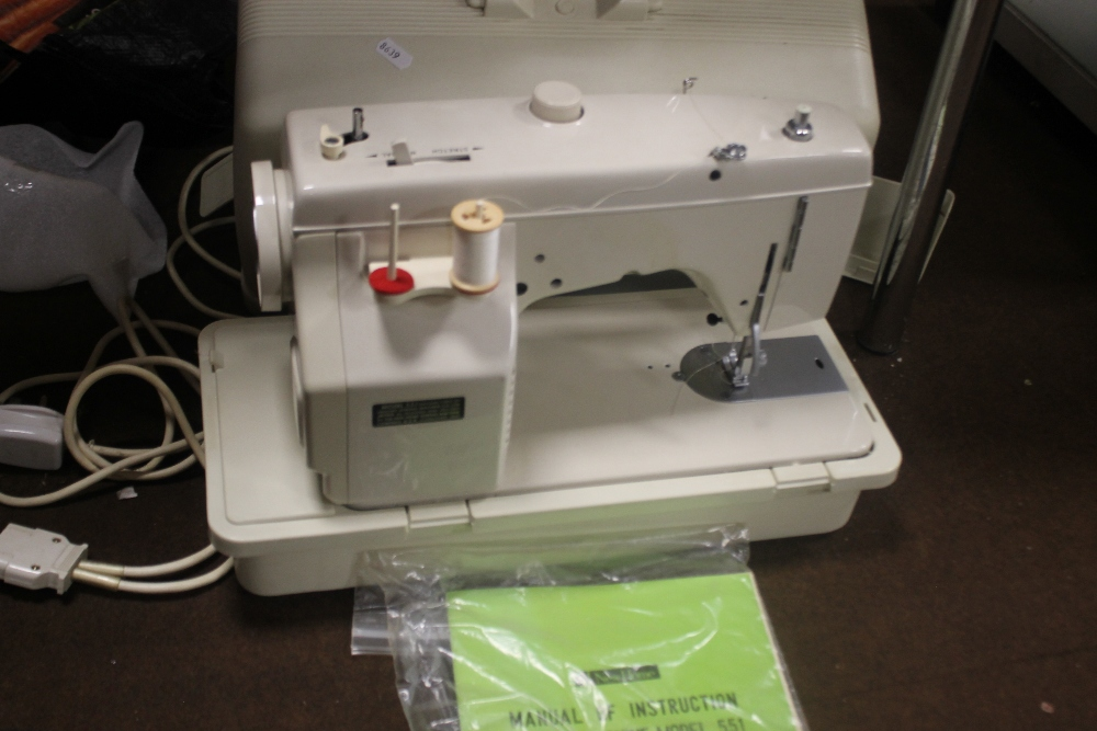 A CASED NEW HOME SEWING MACHINE