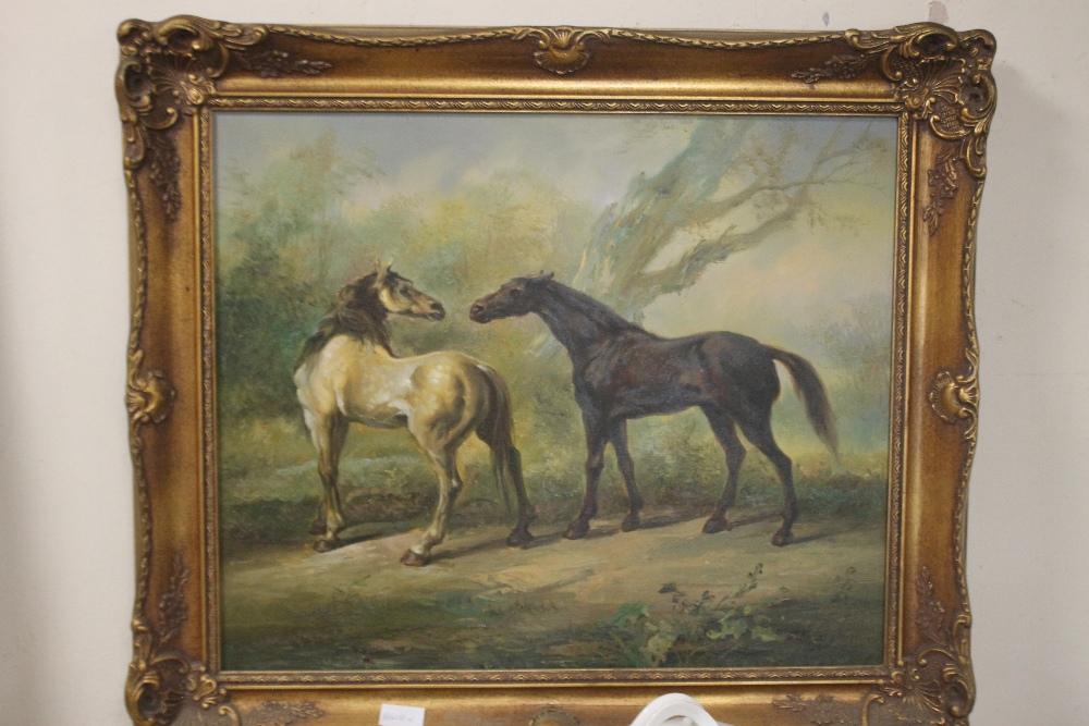 A FRAMED OIL DEPICTING HORSES, signature indistinct