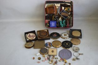 A BOX OF CURIOS, to include 16 compacts, enamel pin badges, pen knives, compass etc