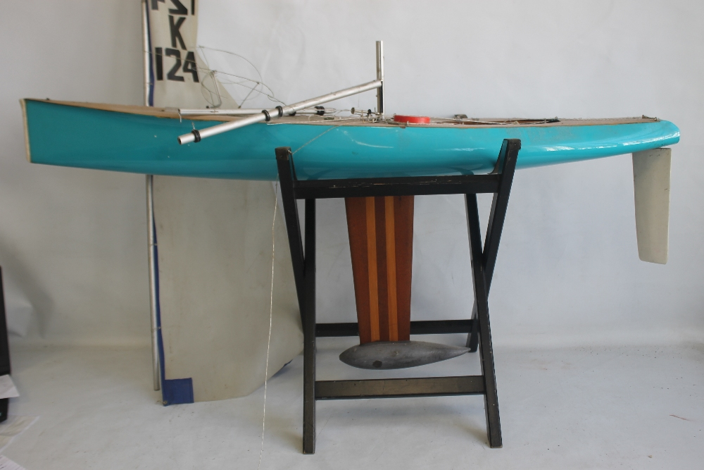A LARGE VINTAGE FIBRE GLASS AND WOOD YACHT AND STAND, 160 cm long with sail