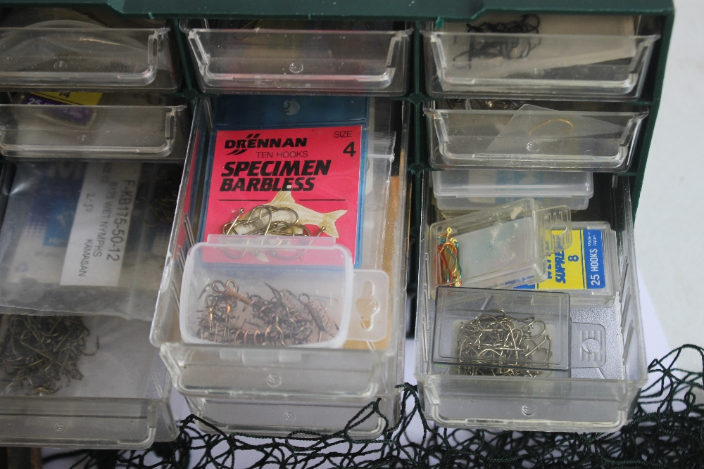 A SMALL CHEST OF ASSORTED FISHING HOOKS VARIOUS SIZES, together with a Mitchell 300 reel, a Moore - Image 3 of 3