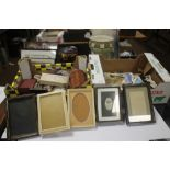 TWO BOXES OF COLLECTABLES TO INCLUDE, a leather cased trio of bottles, a small barometer, two Ronson
