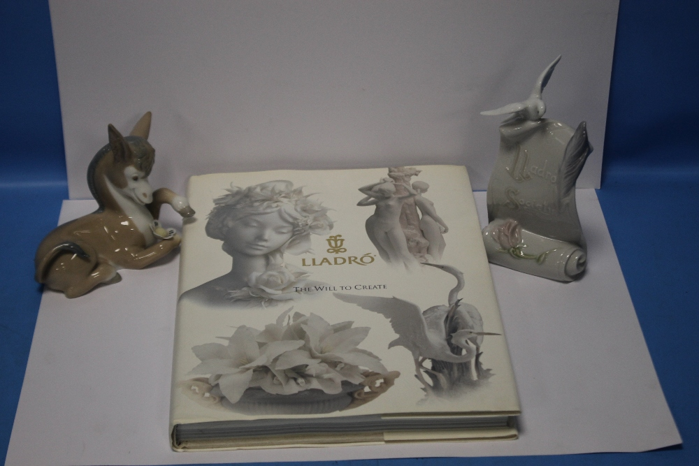 A LLADRO SOCIETY PLAQUE, A LLADRO DONKEY together with a book 'LLadro The Will To Create'