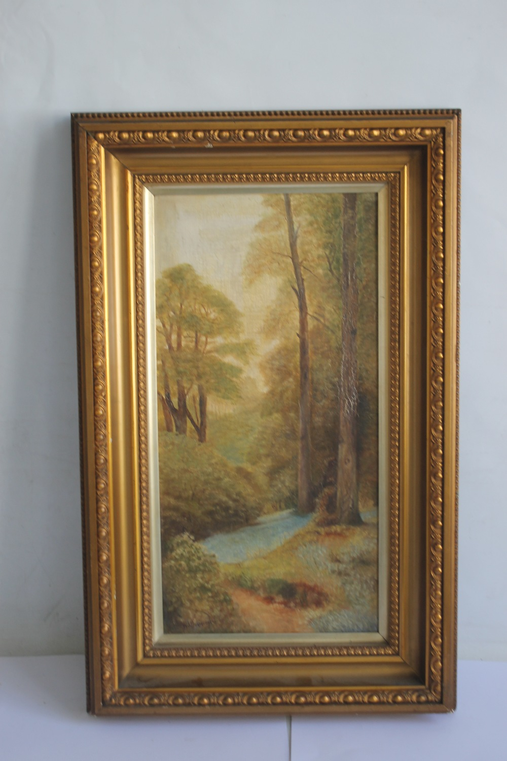 """A FRAMED OIL ON CANVAS OF A WOODLAND SCENE SIGNED """"W. FURMEDGE"""", 68 x 43 cm"""