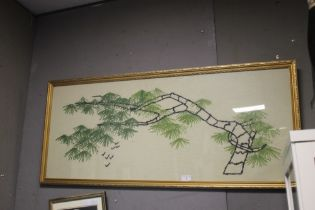 A FRAMED AND GLAZED ORIENTAL STYLE EMBROIDERED PICTURE