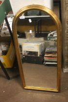 A MODERN GILT FRAMED ARCHED WALL MIRROR 41 CM X 89 CM