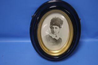 A BELLEEK PORTRAIT PLAQUE OF A VICTORIAN LADY IN A EBONISED FRAME 23 CM X 29 cm