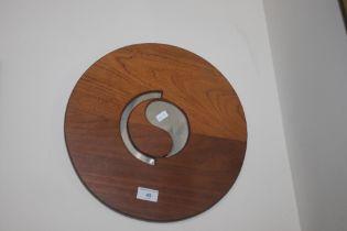 A UNUSUAL SMALL CIRCULAR MIRROR 35.5 CM