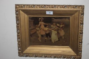 A FRAMED AND GLAZED CHRYSTOLEUM, depicting children doing ring of roses 39 x 33 cm