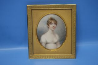 """A 19TH CENTURY MINIATURE PORTRAIT OF A YOUNG LADY IN A GILT METAL FRAME, INSCRIBED TO THE BACK """""""