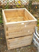 A PAIR OF SQUARE WOODEN PLANTERS