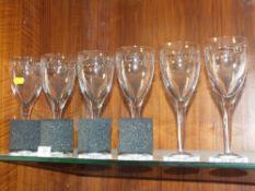 A SET OF SIX JOHN ROCHA WATERFORD CRYSTAL WINE GLASSES