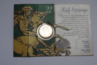 AN ELIZABETH II 2001 GOLD HALF SOVEREIGN ON ROYAL MINT CARD