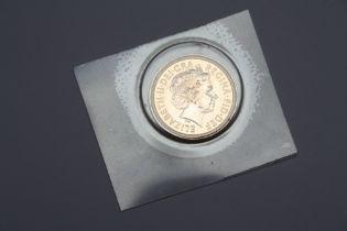 AN ELIZABETH II 2002 GOLD HALF SOVEREIGN - SHIELD BACKED
