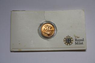 A ROYAL MINT CARDED ELIZABETH II 2010 GOLD HALF SOVEREIGN