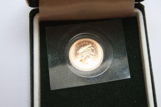 A CASED ELIZABETH II 2000 GOLD HALF SOVEREIGN